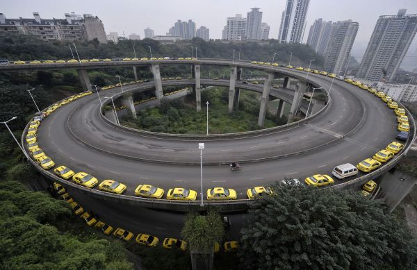 Taxis line up to get their tanks filled on a ramp in Chongqing municipality November 17, 2009