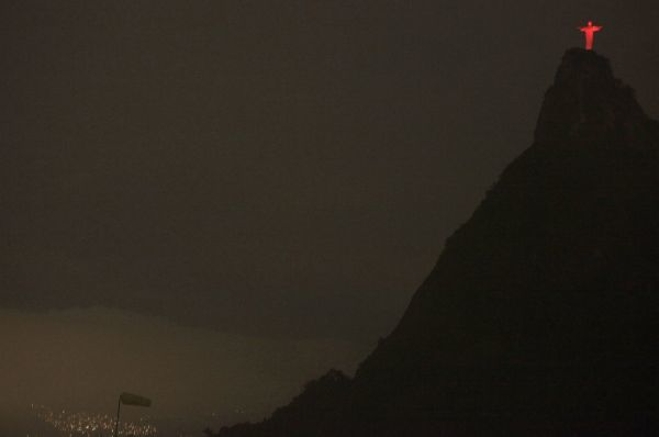 The statue of Christ the Redeemer is seen lit up in red atop the Corcovado mountain during a World AIDS Day event in Rio de Janeiro December 1, 2009. REUTERS/Sergio Moraes (BRAZIL HEALTH SOCIETY RELIGION IMAGES OF THE DAY)