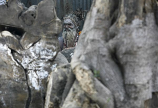 A Hindu monk rests in his makeshift shelter in Kolkata January 5, 2010