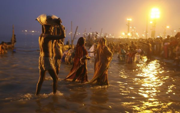 Hindu devotees walk after taking a holy dip at Sangam during Magh Mela, a Hindu festival, in the northern Indian city of Allahabad January 14, 2010