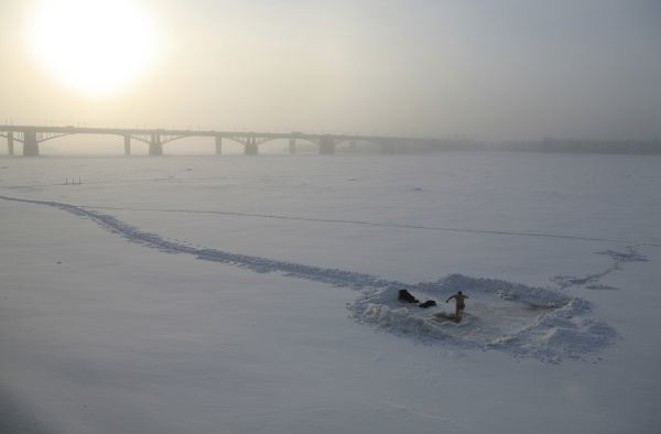 A man prepares to dip in the icy waters of the Ob River in Russia's Siberian city of Novosibirsk, with the air temperature at about minus 30 degrees Celsius (-22 degrees Fahrenheit), during an Orthodox Epiphany celebration, January 19, 2010