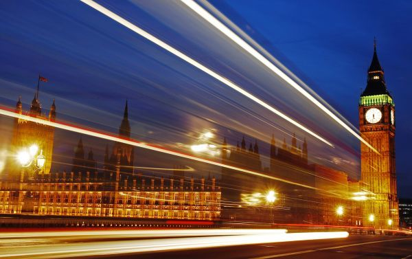 Light trails made by a passing bus illuminate the night sky in front of Britain's Houses of Parliament in London, February 4, 2010
