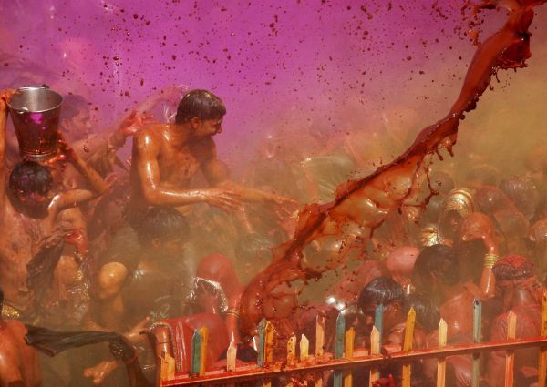"Men and women take part in ""huranga"" in Dauji temple near the northern Indian city of Mathura March 2, 2010. Huranga is a game played between men and women a day after Holi, the festival of colours, during which men drench women with liquid colours"