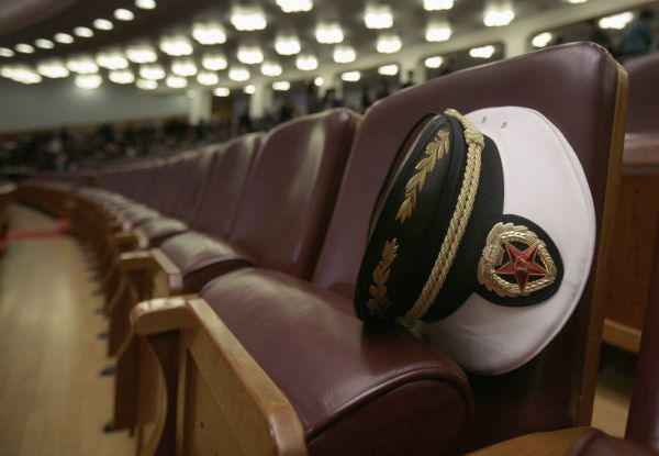 A hat belonging to a Navy delegate of the People's Liberation Army is seen inside the Great Hall of the People, ahead of the third plenary meeting of China's parliament, the National People's Congress (NPC), in Beijing March 9, 2010