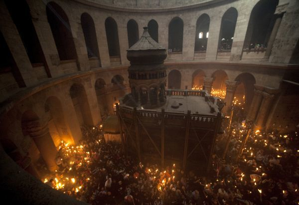 Worshippers hold candles as they take part in the Christian Orthodox Holy Fire ceremony at the Church of the Holy Sepulchre in Jerusalem's Old city April 3, 2010. REUTERS/Ammar Awad (JERUSALEM - Tags: RELIGION IMAGES OF THE DAY)
