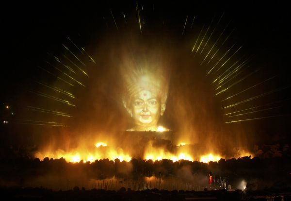 An image of a Hindu god is projected as part of the Sat-Chit-Anand water show with fires and fountains at Akshardham temple in Gandhinagar in the western Indian state of Gujarat April 3, 2010. Picture taken April 3, 2010. REUTERS/Amit Dave (INDIA - Tags