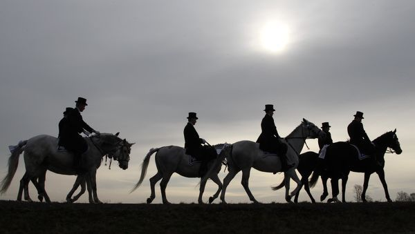 Men of the German Slavic minority Sorbs, dressed in traditional clothes, ride horses during a ceremonial parade near the village of Ralbitz, northeast of Dresden, 4 April, 2010