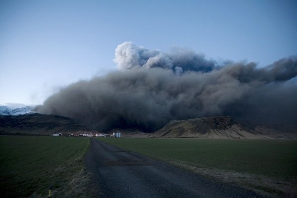 A view of the farm Thorgeirsstadir, as smoke billows from a volcano in Eyjafjallajokull, April 16, 2010. A huge ash cloud from the Icelandic volcano spread out across Europe on Friday causing air travel chaos on a scale not seen since the Sept