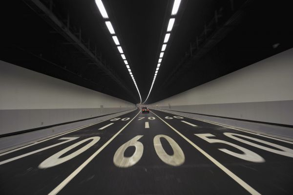 Vehicles travel at the Xiangan undersea highway tunnel in Xiamen, Fujian province April 26, 2010. The first undersea tunnel built in the Chinese mainland opened to traffic in the southeastern province of Fujian on Monday, Xinhua news agency reported