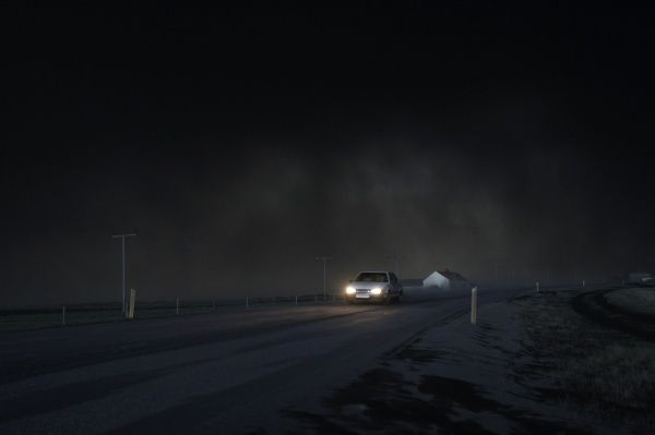 A car drives through ash from Iceland's Eyjafjallajokull volcano in Eyjafjoll May 13, 2010