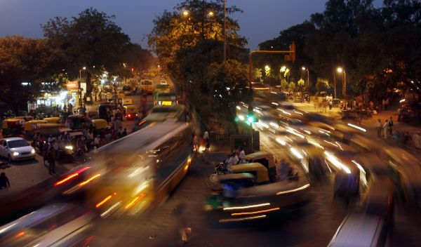 Traffic moves along a busy road in the old quarters of Delhi June 1, 2010