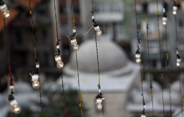 Lightbulbs are tested after they installed between the minarets of Suleymaniye mosque during the installation of mahya in Istanbul August 5, 2010. Mahya, where dangling lights suspended between minarets spell out devotional messages in huge letters
