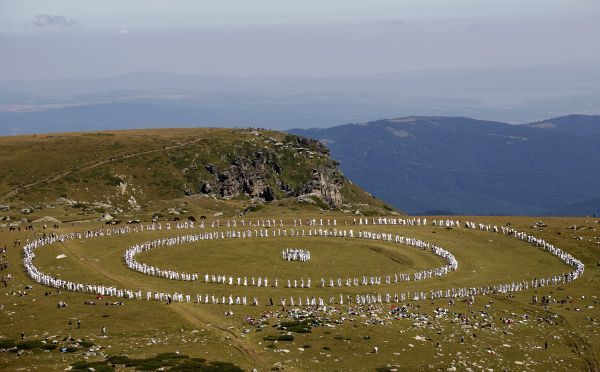 Members of an international religious movement called the White Brotherhood perform a ritual dance known as Paneurhythmy near Babreka lake, in Rila Mountain, 120 km (75 miles) south of Sofia, August 20, 2010