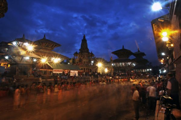 Hindu devotees queue to worship lord Krishna at Krishna temple at Patan near Kathmandu September 1, 2010