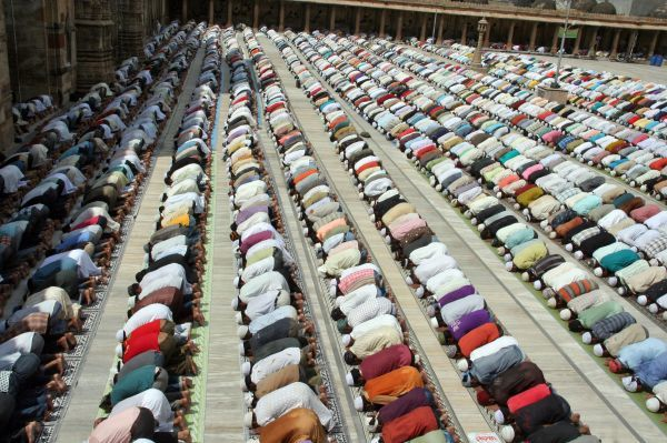 Muslims offer prayers at Juma Masjid on the fourth Friday of the Muslim fasting month of Ramadan in the western Indian city of Ahmedabad September 3, 2010