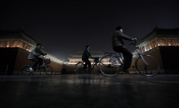 People cycle past Wumen Gate at the Forbidden City in Beijing October 7, 2010. REUTERS/Jason Lee (CHINA - Tags: SOCIETY)