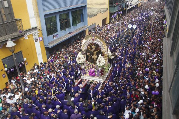 "Thousands of believers dressed in purple congregate to pay homage to a painting of the ""Lord of Miracles,"" Peru's most revered Catholic religious icon, in a major procession through central Lima October 18, 2010"