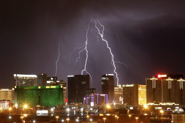 Lightning flashes over Strip casinos as a thunderstorm passes through the Las Vegas Valley in Las Vegas, Nevada October 19, 2010. REUTERS/Steve Marcus (UNITED STATES - Tags: ENVIRONMENT CITYSCAPE)