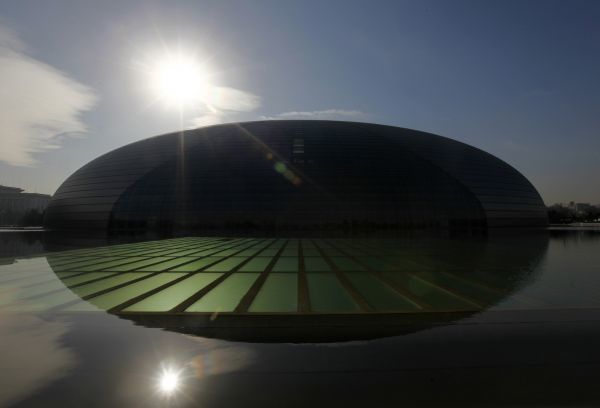 "The National Grand Theatre, also known as the ""egg"", is reflected in the water in central Beijing December 7, 2010. The Theatre has three main halls which include a 2,416-seat opera house, a 2,017-seat concert hall with pipe organ and a 1"
