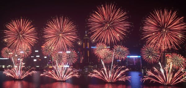 Fireworks explode over Victoria Harbour to celebrate the Chinese Lunar New Year in Hong Kong February 4, 2011. The Lunar New Year began on February 3 and marks the start of the Year of the Rabbit, according to the Chinese zodiac. REUTERS/Tyrone Siu