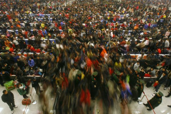 Passengers leave Wuhan Railway Station after the week-long Chinese New Year holidays, in Hubei province February 9, 2011