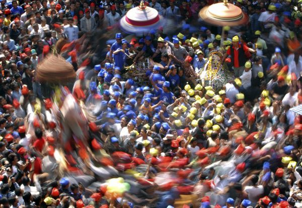 A slow motion picture of devotees carrying chariots as they participate in the Chariot Festival in Kathmandu April 4, 2011