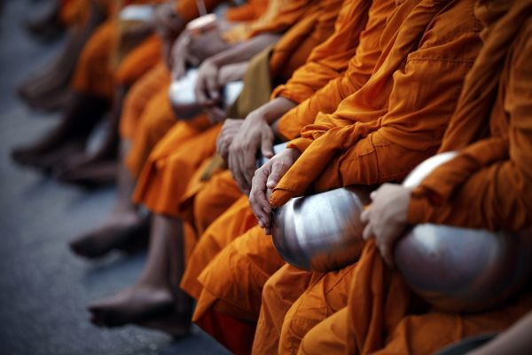 Buddhist monks attend an alms offering ceremony in Bangkok's shopping district May 8, 2011. Buddhist monks, numbering 12,600, according to organisers, attended the ceremony on Vesak Day, the annual celebration of Buddha's birth, enlightenment and death
