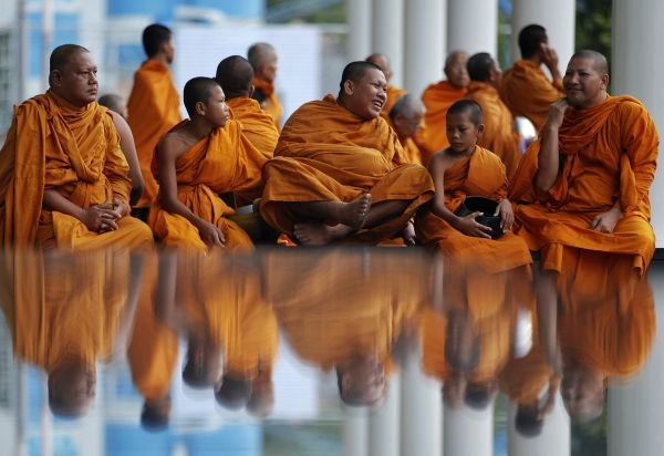 Buddhist monks attend an alms offering ceremony at Bangkok's shopping district May 8, 2011. Buddhist monks, numbering 12,600, according to organisers, attended the ceremony on Vesak Day, the annual celebration of Buddha's birth, enlightenment