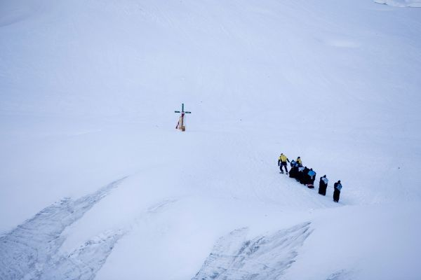 """Ukukus"" or protectors of the Lord ""Qoyllur Rit'i"" try to reach to a cross on a glacier during celebrations in honor of the Lord at the Sinakara Valley in Cuzco, June 21, 2011"
