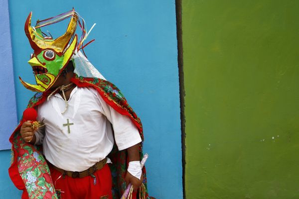 A man dressed as a devil takes part in a parade celebrating the Catholic festival of Corpus Christi in Ocumare de la Costa in the central state of Aragua June 23, 2011