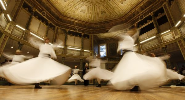 Whirling dervishes perform before an Iftar, the evening meal for breaking fast during Ramadan, organized by Beyoglu municipality at the historical Galata Mevlevi Temple in Istanbul August 2, 2011
