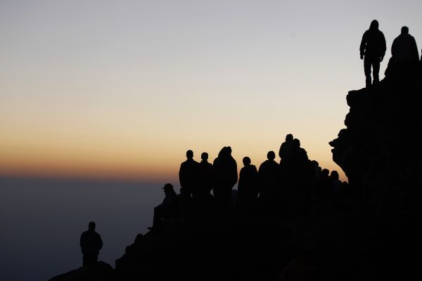 Members of an international religious movement called the White Brotherhood wait for the sunrise on the top of their prayer hill in Rila Mountain, some 100 km (62 miles) south of Sofia, early August 19, 2011, as part of celebration of their New Year