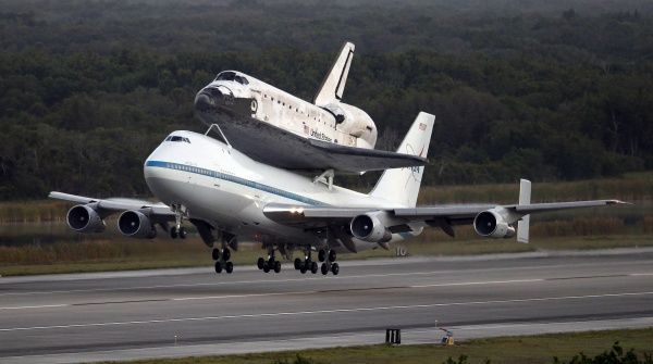 The space shuttle Discovery, attached to a modified NASA 747 aircraft, takes off headed for its final home at The Smithsonian National Air and Space Museum Steven F. Udvar-Hazy Center in Chantilly, Virginia, from the Kennedy Space Center in Cape Canaveral