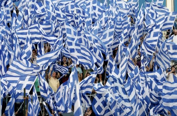 Greek conservative party supporters wave flags during a pre-election rally by their leader Antonis Samaras in the town of Thessaloniki May 2, 2012