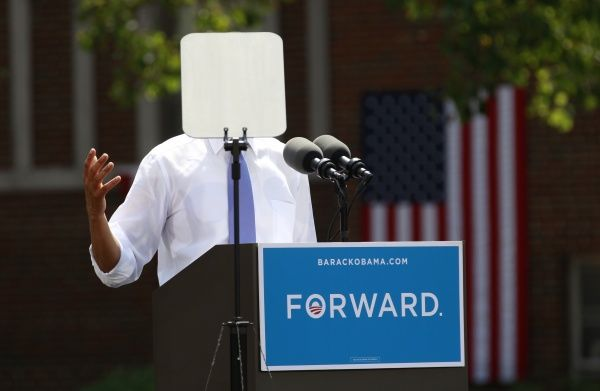 A teleprompter obscures U.S. President Barack Obama as he speaks during a campaign event at Capital University in Columbus, Ohio August 21, 2012. Obama is on a two-day campaign trip to Ohio, Nevada and New York.  REUTERS/Kevin Lamarque (UNITED STATES - Tags