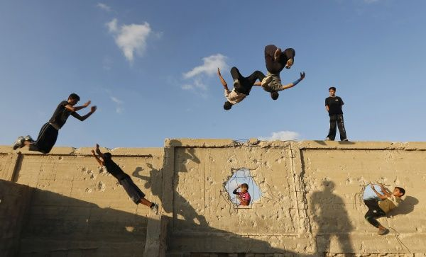 Palestinian youths practice their parkour skills in Khan Younis in the southern Gaza Strip September 12, 2012