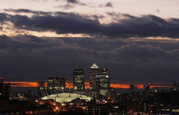 The O2 Arena (foreground) and other buildings are seen in the Canary Wharf business district of east London on November 22, 2008 REUTERS/Jonathan Bainbridge (BRITAIN)