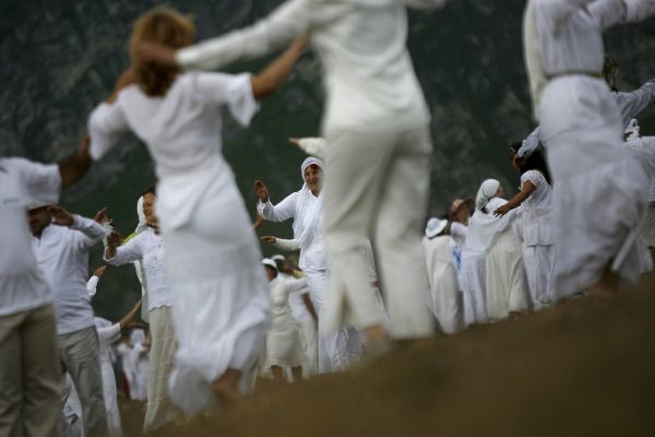 Members of an international religious movement called the White Brotherhood perform a ritual dance near Babreka lake, in Rila Mountain, 120 km (75 miles) south of Sofia, August 19, 2009, as part of celebration of their New Year. The teaching of the movement