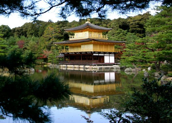 A view of the Golden Pavilion Kinkakuji Temple as it is reflected in water in Kyoto, Japan November 15, 2005. U.S. President George W. Bush and first lady Laura Bush will visit the temple on the first full day of their eight-day trip to Asia on Tuesday