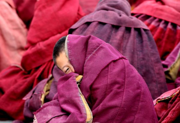 QUALITY REPEAT Ethnic Tibetan monks attend prayers at the Labrang Monastery in Xiahe, western China's Gansu province, February 9, 2006. Thousands of Tibetan pilgrims will celebrate the Monlam or Great Prayer Festival from February 9 to 13