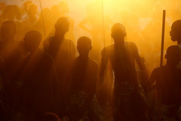 Senegalese youths are silhouetted against dust kicked up during a traditional Ekonkon dance at sunset in the village of Kabousse, in the West African country's southern Casamance region January 8, 2006