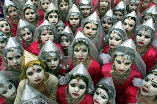 Indian schoolgirls dressed as puppets pose after a puppet show in the northern city of Chandigarh November 19, 2003