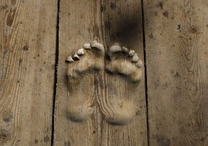 Footprints carved in wood, which locals believe were made by a worshipper who prayed